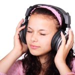 image of a girl using a wireless headphone